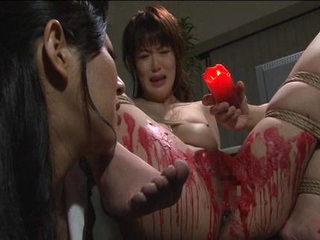 Wax is dripped all over sexy Japanese sub